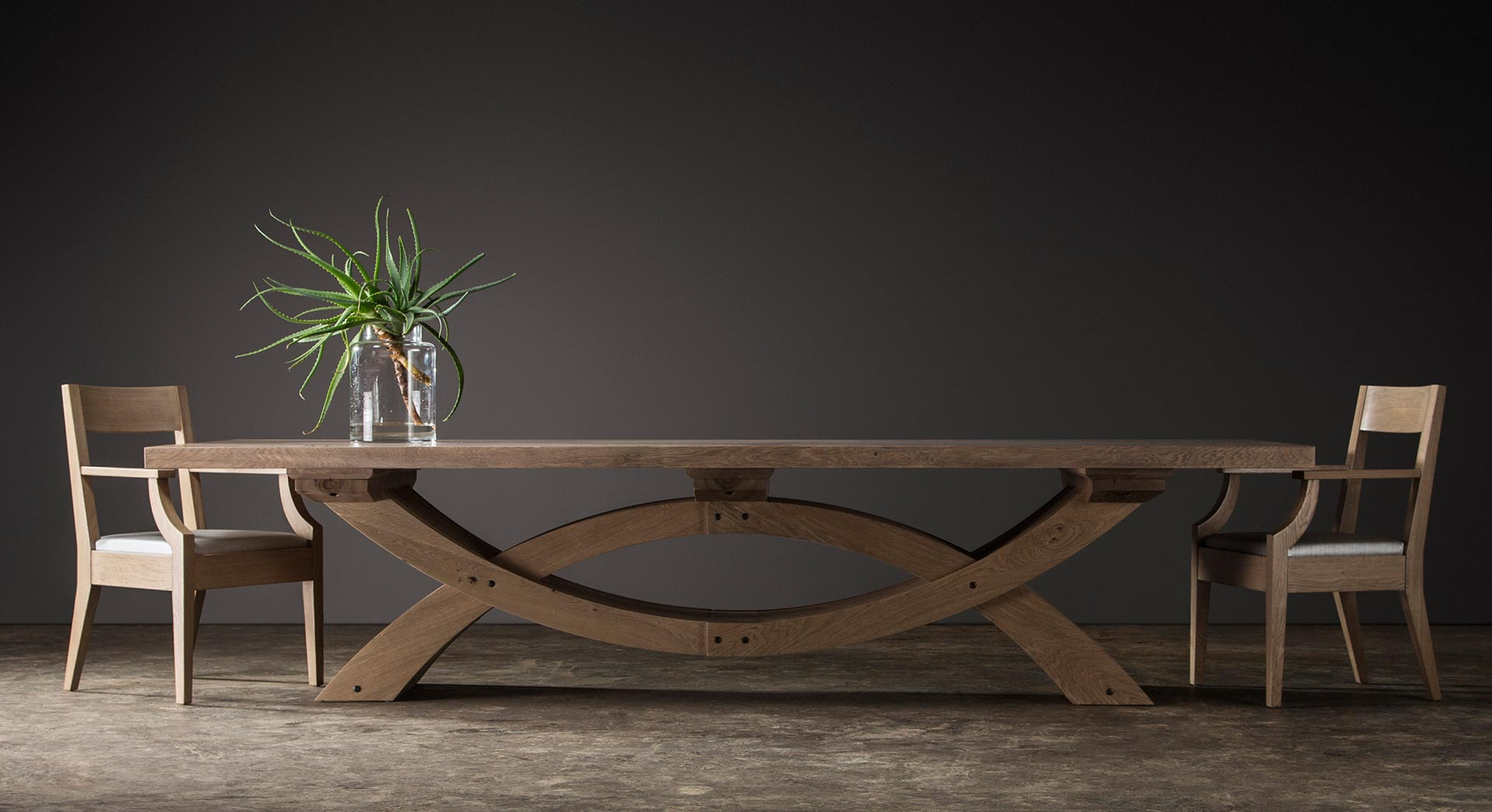 Trojan Dining Table with two Metro Carvers